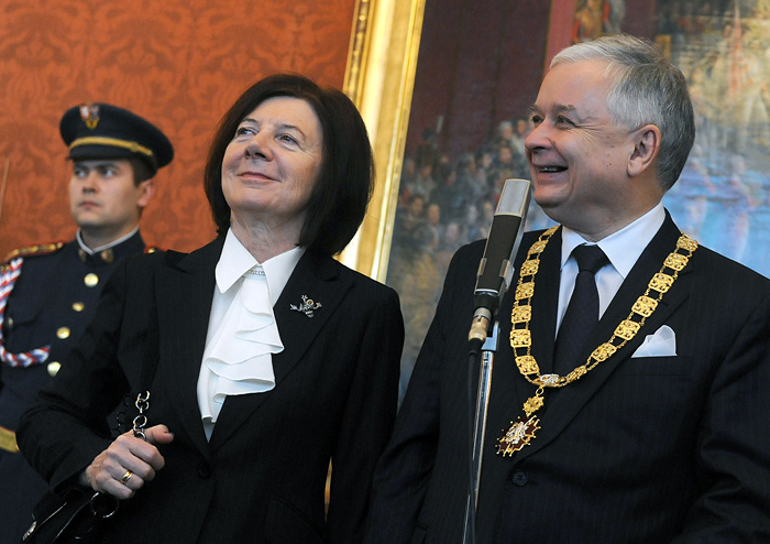 """(FILES) -- A file photo taken on January 21, 2010 shows Polish President Lech Kaczynski and his wife Maria smiling after he received the highest state decoration """"the Order of the White Lion'' from the hands of Czech President Vaclav Klaus (unseen) at Prague Castle in Prague. A plane carrying Polish president Lech Kaczynski, his wife and much of the country's military and state elite crashed in thick fog in Russia on April 10, 2010 killing all 96 people on board in a blazing inferno.        AFP PHOTO / MICHAL CIZEK"""
