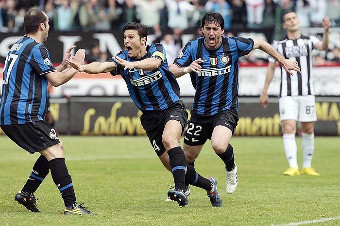 Inter Milan's Argentine striker Diego Milito, right, celebrates with his teammates Javier Zanetti, center, and Goran Pandev after scoring his side 1-0, during the Serie A soccer match between Siena and Inter Milan, in Siena, Italy, Sunday, May 16,  2010. (AP Photo/Gregorio Borgia)
