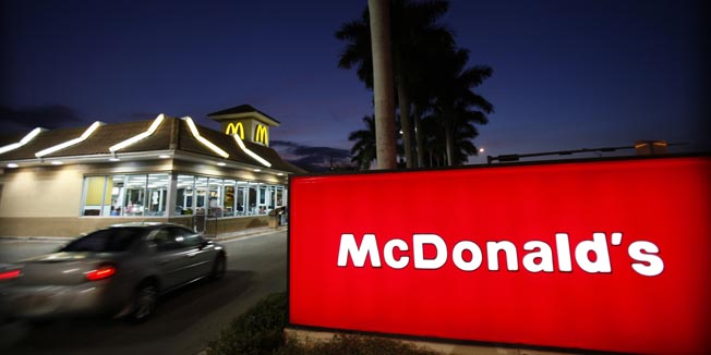 FILE - In this Jan. 20, 2010 file photo, a McDonald's restaurant is shown in Doral, Fla. McDonald's Corp. said Monday, May 10, 2010, a key performance measure climbed in April, as customers spent more money to buy everything from iced coffee drinks to chicken nuggets.(AP Photo/Wilfredo Lee, file)