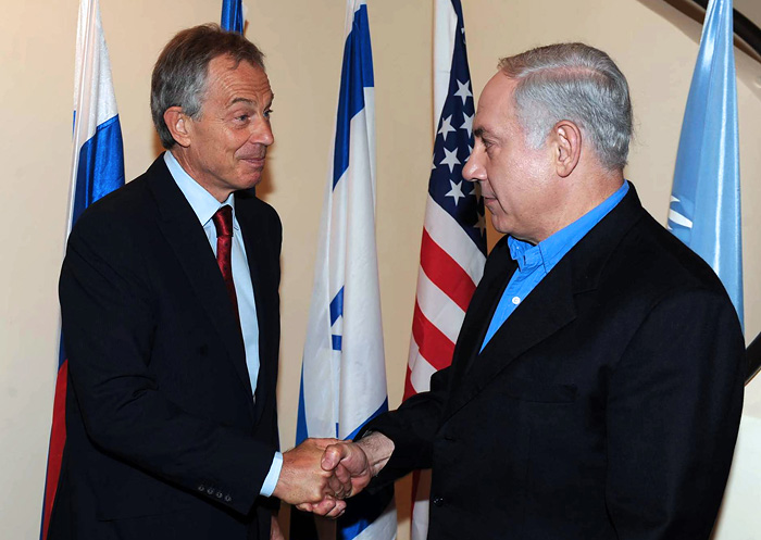 A handout picture from the Israeli Government Press Office shows Middle East Quartet Envoy Tony Blair (L) shaking hands with Israeli Prime Minister Benjamin Netanyahu on June 11, 2010 in Jerusalem. AFP PHOTO/GPO/AMOS BEN GERSHOM