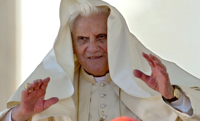 Pope Benedict XVI's cloak is lifted by the wind during his weekly general audience in St. Peter's Square, at the Vatican, Wednesday, Oct. 21, 2009. (AP Photo/Andrew Medichini)