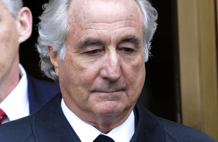 FILE - In this March 10, 2009 file photo, Bernard Madoff exits Manhattan federal court in New York. The watchdog of the Securities and Exchange Commission has found that the agency consistently mishandled its investigations of Bernard Madoff's business, despite ample warnings of the multibillion-dollar fraud, according to a report released Wednesday, Sept. 2, 2009. (AP Photo/Louis Lanzano, file)