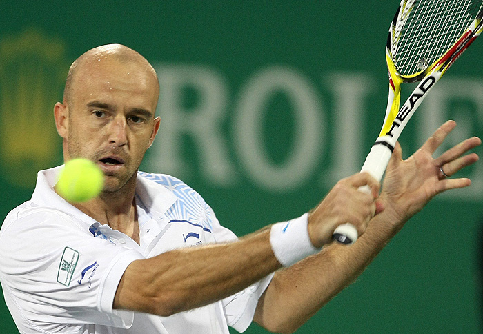 Ivan Ljubicic of Croatia plays a shot to Gael Monfils of France during the Shanghai Masters tennis tournament in Shanghai October 15, 2009. REUTERS/Aly Song (CHINA SPORT TENNIS)