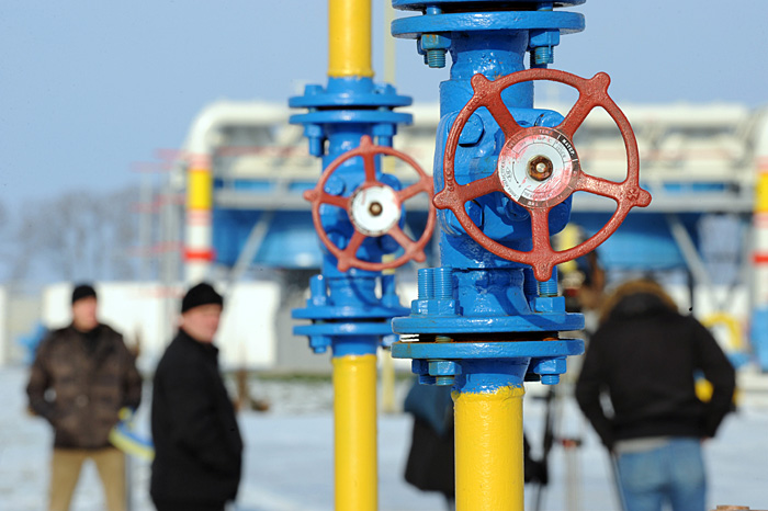 """(FILES) The picture taken on December 16, 2008 shows workers of Naftogaz company leaving the newly built Bobrovnytska gas-compressor and gas-holder station in Mryn, Chernigiv region, about 130 km from Kiev. On November 2, 2009 Russian Prime Minister Vladimir Putin warned that the European Union should """"open its wallet"""" to extend a loan to Ukraine for paying its gas bills to Russia. The statement came after Russian gas supplies were cut off to over a dozen European countries for two weeks in January as part of a bitter dispute over payments and prices between Moscow and Kiev. AFP PHOTO/ SERGEI SUPINSKY"""