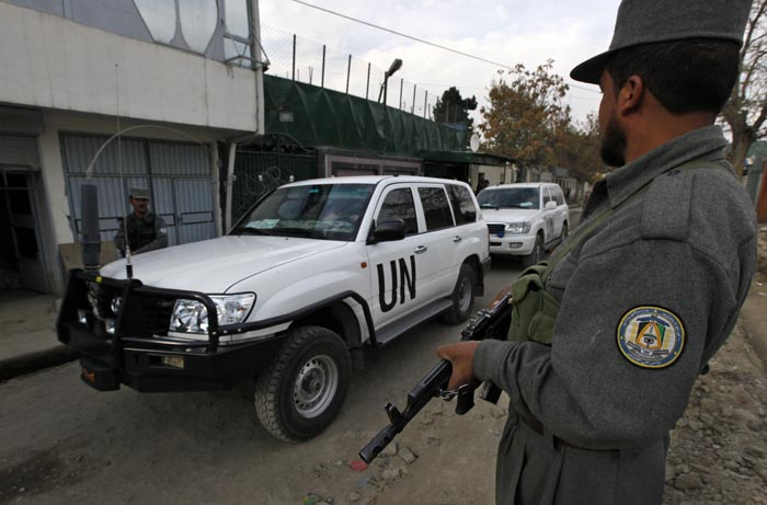A convoy of U.N. cars leaves after U.N. staff visited the destroyed guesthouse that left five U.N. staffers dead in Kabul, Afghanistan, Thursday, Nov. 5, 2009. The United Nations said Thursday that it is temporarily relocating more than half its international staff in Afghanistan following last week's deadly Taliban attack against U.N. workers, the most direct targeting of its employees during decades of work in the country. (AP Photo/Gemunu Amarasinghe)