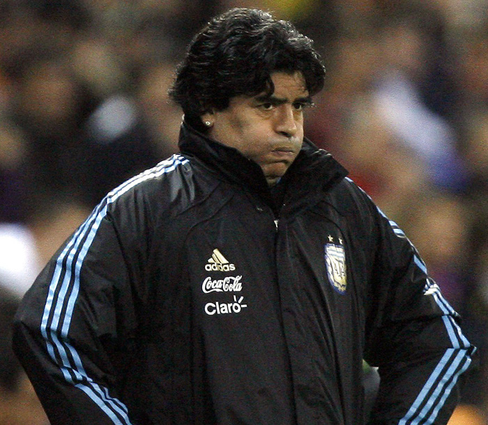 Argentina's national soccer coach Diego Maradona reacts during their friendly soccer match against Spain at the Vicente Calderon stadium in Madrid in this November 14, 2009 file photo. Maradona has been given a two-month ban and fined over $24,000 following his globally-broadcast foul-mouthed outburst at the end of last month's decisive World Cup qualifier in Uruguay. Maradona was handed the ban by FIFA's disciplinary committee on November 15, 2009.     REUTERS/Nacho Doce/Files (SPAIN SPORT SOCCER)