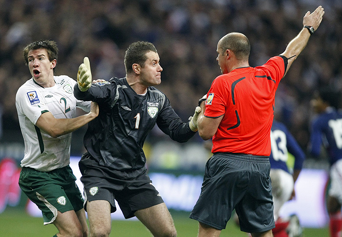 Republic of Ireland's Sean St Leger, left, and goalkeeper Shay Given, center, argues with Swedish referee Martin Hansson after France scores a goal during their World Cup qualifying playoff second leg soccer match at Stade de France, in Saint Denis, north outskirts of Paris, Wednesday Nov. 18, 2009. (AP Photo/Francois Mori)