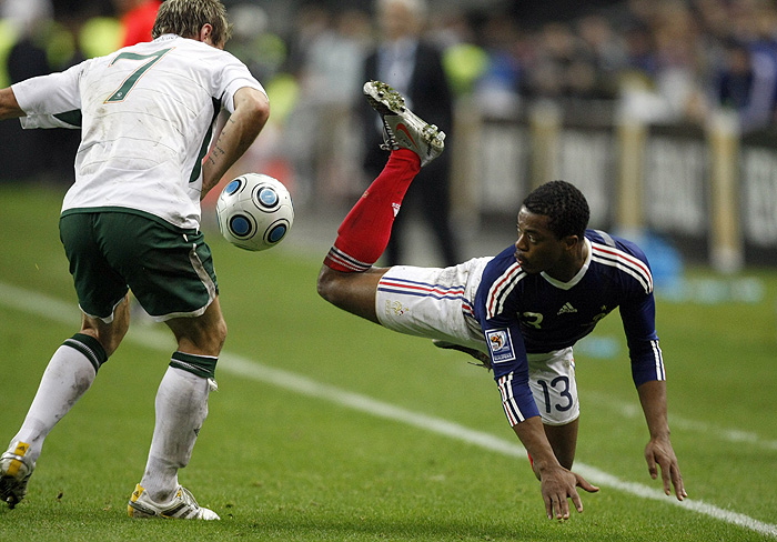 France's Patrice Evra, right, challenges Republic of Ireland's Liam Lawrence during their World Cup qualifying playoff second leg soccer match at Stade de France, in Saint Denis, north outskirts of Paris, Wednesday, Nov. 18, 2009. (AP Photo/Francois Mori)