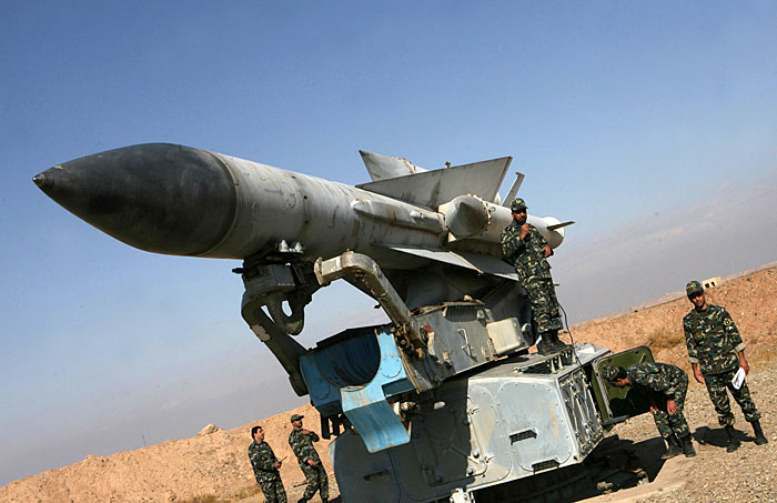 Iranian soldiers stand near a S-200 surface-to-air missile during military manoeuvres in Iran on November 26, 2009. Iran began five days of manoeuvres on November 22 aimed at preparing responses to aerial threats against the country's nuclear facilities -- from reconnaissance to actual assault. AFP PHOTO/FARS NEWS/ALI SHAYEGAN