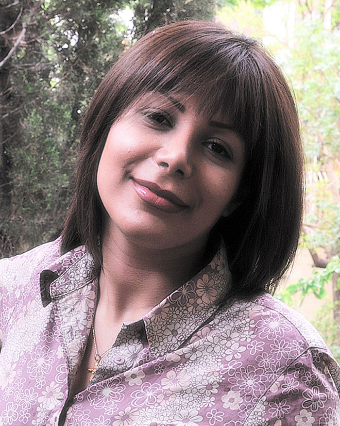 FILE - This photo dated May 2009 and provided by Caspian Makan, 37-year-old photojournalist in Tehran who identified himself as the boyfriend of Neda Agha Soltan. The photo purports to show Neda Agha Soltan whose death on a Tehran, Iran, street was captured graphically on amateur videos which were published on the World Wide Web. Iran has protested to an Oxford University college over a scholarship in memory of the slain Iranian student who became an icon of mass street protests sparked by the disputed June election. In Tehran, a small group of hard-line women demonstrated Wednesday, Nov. 11, 2009 against the scholarship in front of the British Embassy. (AP Photo/Courtesy Caspian Makan, File)  EDS NOTE: THE AP CANNOT INDEPENDENTLY VERIFY THE AUTHENTICITY OF THIS IMAGE -  EDITORIAL USE ONLY