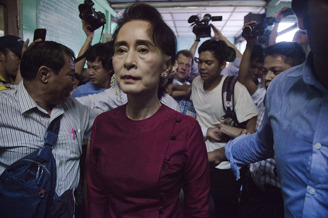 Myanmar opposition leader and head of the National League for Democracy (NLD) Aung San Suu Kyi leaves a polling station after casting her vote in Yangon on November 8, 2015. The historic poll could see Suu Kyi's opposition launched to power after decades of army rule. AFP PHOTO / Nicolas ASFOURI