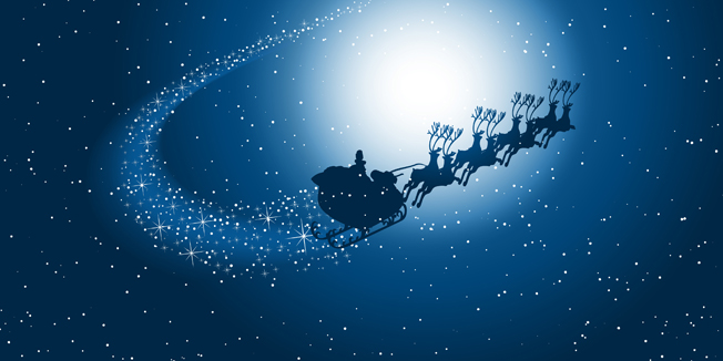 Silhouette of santa flying through the snowy night sky with starry trail