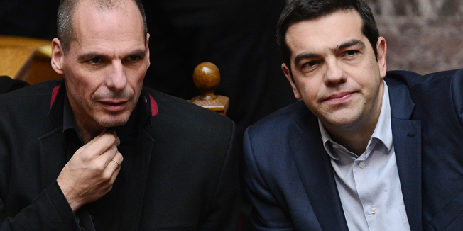 Greek Prime Minister Alexis Tsipras (R) and Finance Minister Yianis Varoufakis sit during the vote for  president at the Greek parliament in Athens on February 18, 2015.  Finance Minister Yanis Varoufakis said Wednesday Athens' formal request for a loan extension from the EU would meet the demands of both the Greeks and the Eurogroup, and he was optimistic a deal could be reached. AFP PHOTO / LOUISA GOULIAMAKI