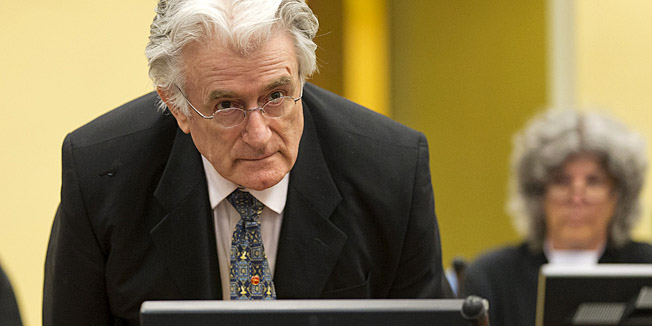 Bosnian Serb wartime leader Radovan Karadzic appears in the courtroom for his appeals judgement at the International Criminal Tribunal for Former Yugoslavia (ICTY) in The Hague, The Netherlands, on July 11 2013. AFP PHOTO/ POOL/MICHAEL KOOREN