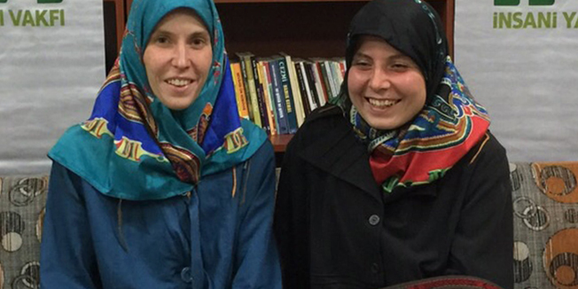 "A handout picture taken March 27, 2015 and released on March 28, 2015 by the IHH (The Foundation for Human Rights and Freedom and Humanitarian Relief) shows two Czech women Antonie Chrastecka (L) and Hana Humpalova (R) posing after being rescued in Van, eastern Turkey, on March 27, 2015. Two young Czech women kidnapped in Pakistan in 2013 have been freed and have returned home, Prime Minister Bohuslav Sobotka said on March 28. He added that the two 26-year-old women were freed with the help of the Turkish Muslim humanitarian organisation IHH.  AFP PHOTO / IHHRESTRICTED TO EDITORIAL USE MANDATORY CREDIT ""AFP PHOTO / IHH"" - NO MARKETING NO ADVERTISING CAMPAIGNS - DISTRIBUTED AS A SERVICE TO CLIENTS"