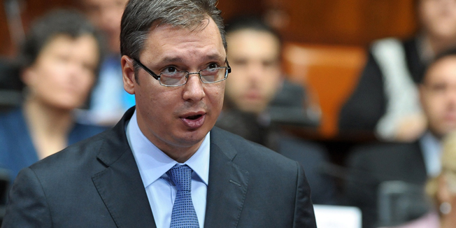 Deputy Prime Minister Aleksandar Vucic (C) and leader of the ruling Serbian Progressive Party (SNS) speaks during a parliamentary session at the Serbian National assembly in Belgrade on April 27, 2014.  AFP PHOTO / ALEXA STANKOVIC