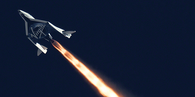 """This handout file image obtained October 31, 2014, courtesy of NASA and  Mars Scientific/Clay Center Observatory shows SpaceShipTwo as it completed its second powered flight on  September 5,2013 over the Mojave desert.  Virgin Galactic's SpaceShipTwo craft suffered an """"anomaly"""" during a test flight over California on October 31, 2014, the commercial space flight operator announced on its Twitter feed. The craft, which is still in its test phase and which normally carries two pilots, had been carried aloft on a bigger aircraft known as WhiteKnightTwo and then released for a test of its rocket engine. The fate of the crew was not immediately known. """"SpaceShipTwo has experienced an in-flight anomaly. Additional info and statement forthcoming,"""" Virgin said, giving no further details. This image was taken by MARS Scientific as part of the Mobile Aerospace Reconnaissance System optical tracking system. AFP PHOTO/NASA/Mars Scientific/Clay Center Observatory /HANDOUT =  RESTRICTED TO EDITORIAL USE / MANDATORY CREDIT: """"AFP PHOTO HANDOUT-NASA/Mars Scientific/Clay Center Observatory""""/ NO MARKETING - NO ADVERTISING CAMPAIGNS/  NO A LA CARTE SALES / DISTRIBUTED AS A SERVICE TO CLIENTS /  ="""