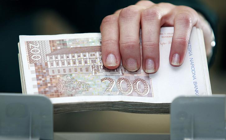 Zagreb, 130208.Sjediste HYPO grupe, Slavonska avenija. Banka - ilustracije.Brojanje novca.  Foto: Elvir Tabakovic / CROPIX