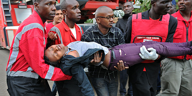 TOPSHOTSA woman who had been held hostage is carried in shock by rescue personnel on September 21, 2013, after she was freed following a security operation at an upmarket shopping mall in Nairobi where suspected terrorrists engaged Kenyan security forces in a drawn out gun fight. Some 20 people have been killed and about 50 wounded Saturday in the initial attack by the gunmen the Kenya Red Cross said.  AFP PHOTO / Tony KARUMBA