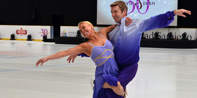 Great Britain's figure skaters, Jane Torvill (L) and Christopher Dean (R) skate on the ice at the Zetra Olympic hall in Sarajevo, on February 13, 2014. Torvill and Dean take part in celebration of the 30th anniversary of 14th Winter Olympic Games, hosted by Bosnia and Herzegovina's capital in 1984, when the famous British duo won the Olympic gold medal. AFP PHOTO / ELVIS BARUKCIC