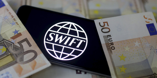 Swift code bank logo is displayed on an iPhone 6s on top of Euro banknotes in this picture illustration made in Zenica, Bosnia and Herzegovina, January 26, 2016.   REUTERS/Dado Ruvic/File Photo      TPX IMAGES OF THE DAY
