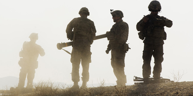 U.S. soldiers from D Troop of the 3rd Cavalry Regiment walk on a hill after finishing with a training exercise near forward operating base Gamberi in the Laghman province of Afghanistan December 30, 2014. REUTERS/Lucas Jackson (AFGHANISTAN - Tags: CIVIL UNREST POLITICS MILITARY TPX IMAGES OF THE DAY) - RTR4JLJC
