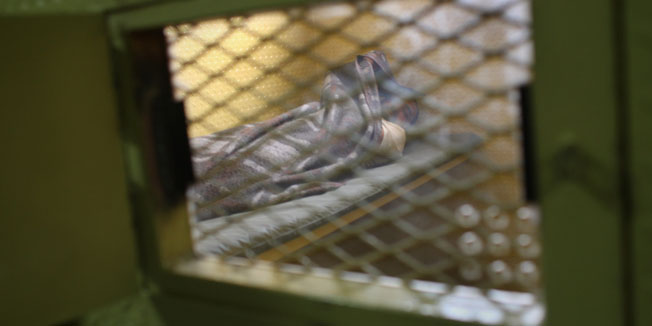 "BAGHDAD, IRAQ - SEPTEMBER 20:  An Iraqi detainee on ""death row"" rests in his solitary confinement cell at the Camp Cropper detention center September 20, 2007 in Baghdad, Iraq. He was first detained by U.S. forces, later tried by an Iraqi criminal court for murder and sentenced to death, and he is now being held by U.S. forces at Camp Cropper until his execution by Iraqi authorities. He is currently one of three convicted Iraqis with such status at Camp Cropper awaiting execution by Iraqi authorities. The U.S. military has some 25,000 detainees in custody in Iraq, accused of attacks against American and Iraqi forces as well criminal acts.  (Photo by John Moore/Getty Images)"