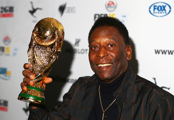 Pele holds a replica Wolrd Cup trophy during a press conference at The Peninsula on March 26, 2015 in Melbourne, Australia.  (Photo by Robert Cianflone/Getty Images)