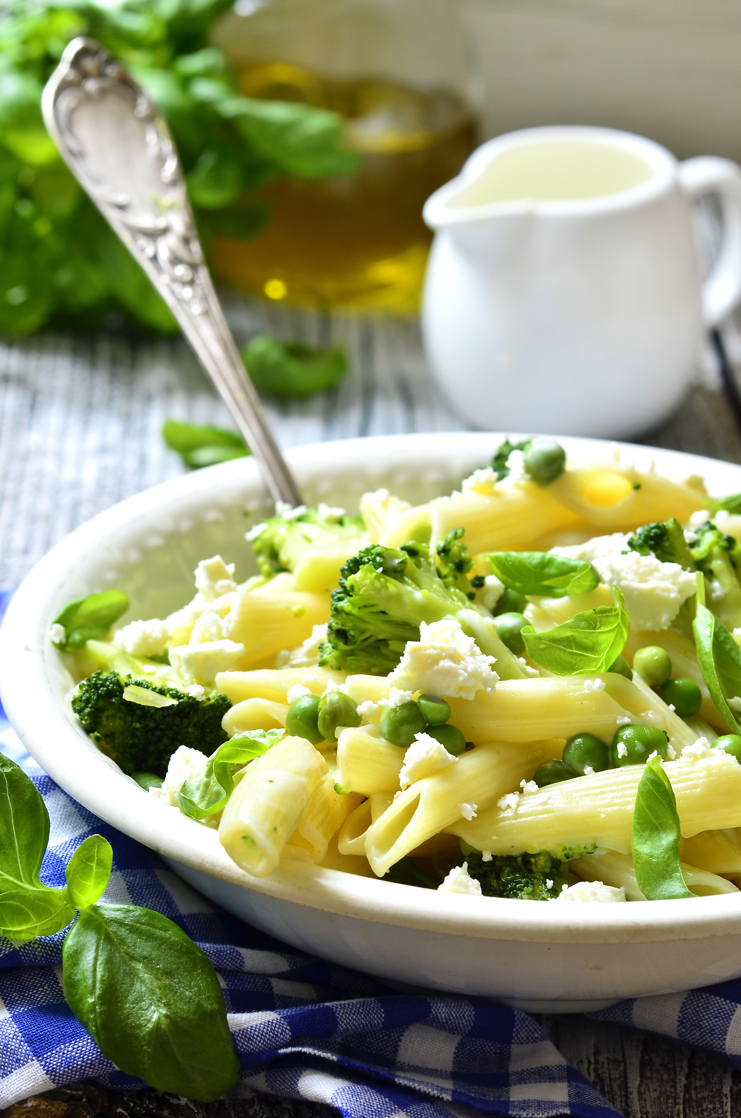 Penne with green vegetables and feta cheese in cream sause.