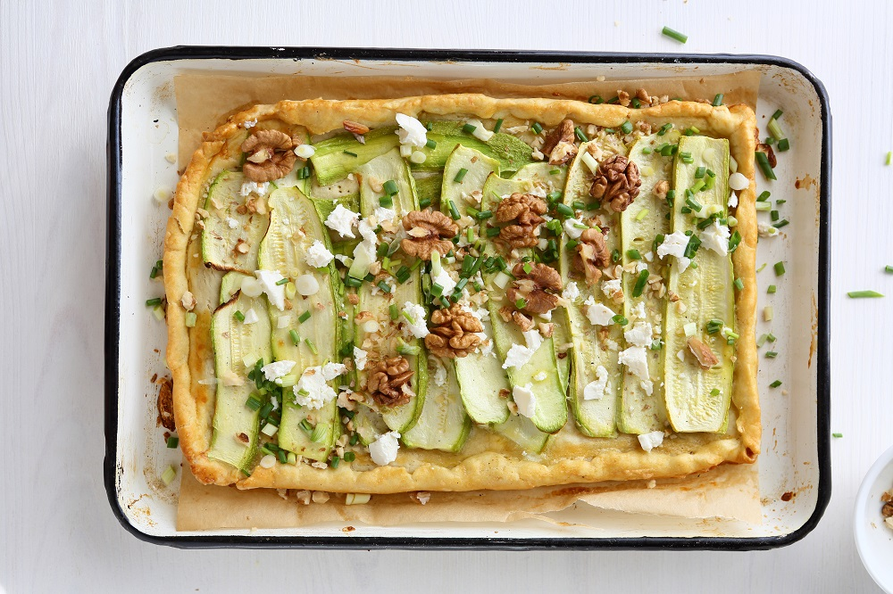 tart with zucchine slice on baking sheet