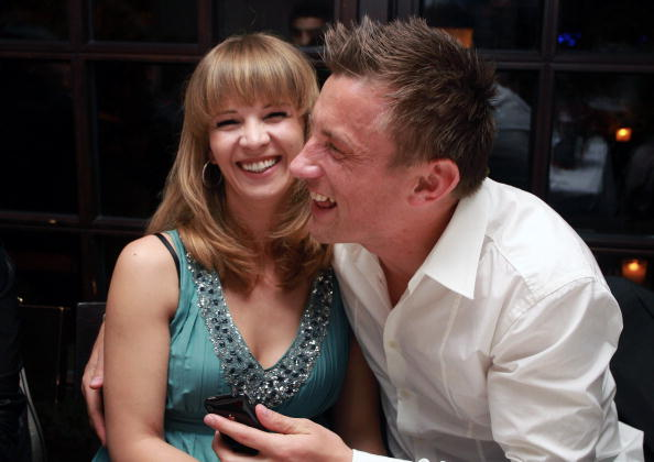 MUNICH, GERMANY - MAY 08:  Ivica Olic of Bayern Muenchen and his wife Natalie laugh during a dinner to celebrate their German Championship title on May 8, 2010 in Munich, Germany.  (Photo by Alexandra Beier/Bongarts/Getty Images)