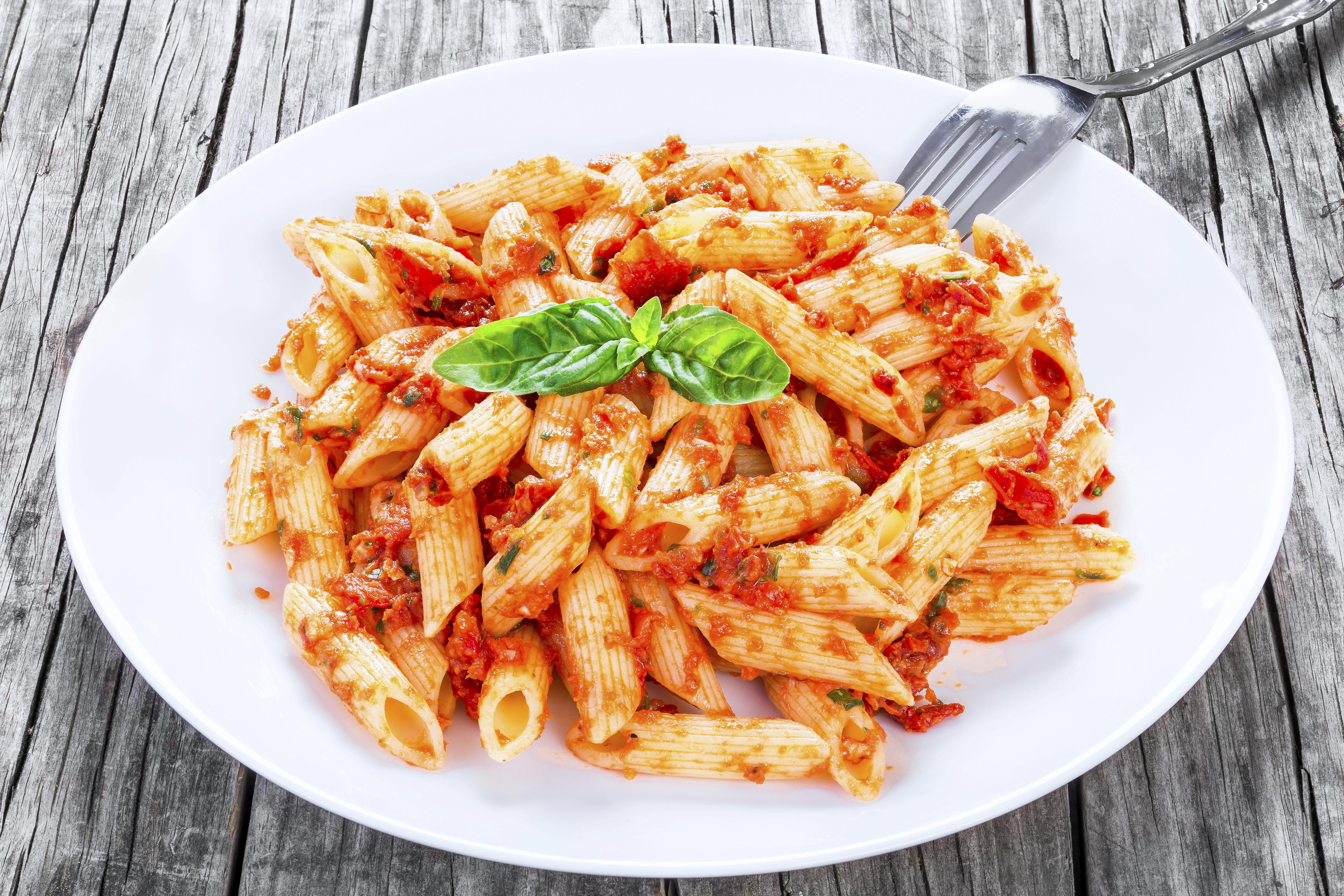 Italian Pasta Penne with Sun-Dried Tomato Pesto, close-up