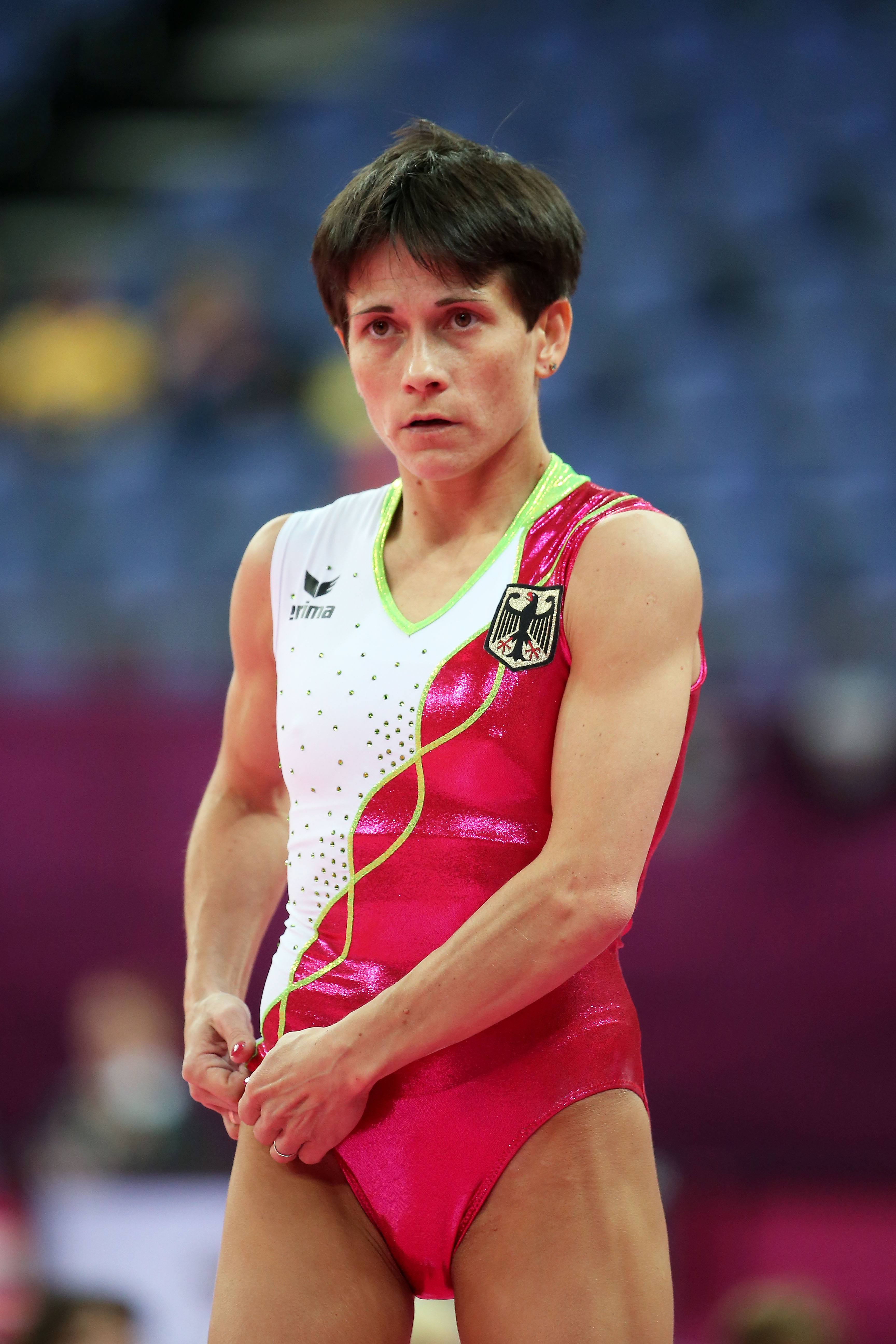 LONDON, ENGLAND - JULY 26:  Oksana Chusovitina of Germany looks on during training sessions for Artistic Gymnastics ahead of the 2012 Olympic Games at Greenwich Training Academy on July 26, 2012 in London, England.  (Photo by Christian Petersen/Getty Images)