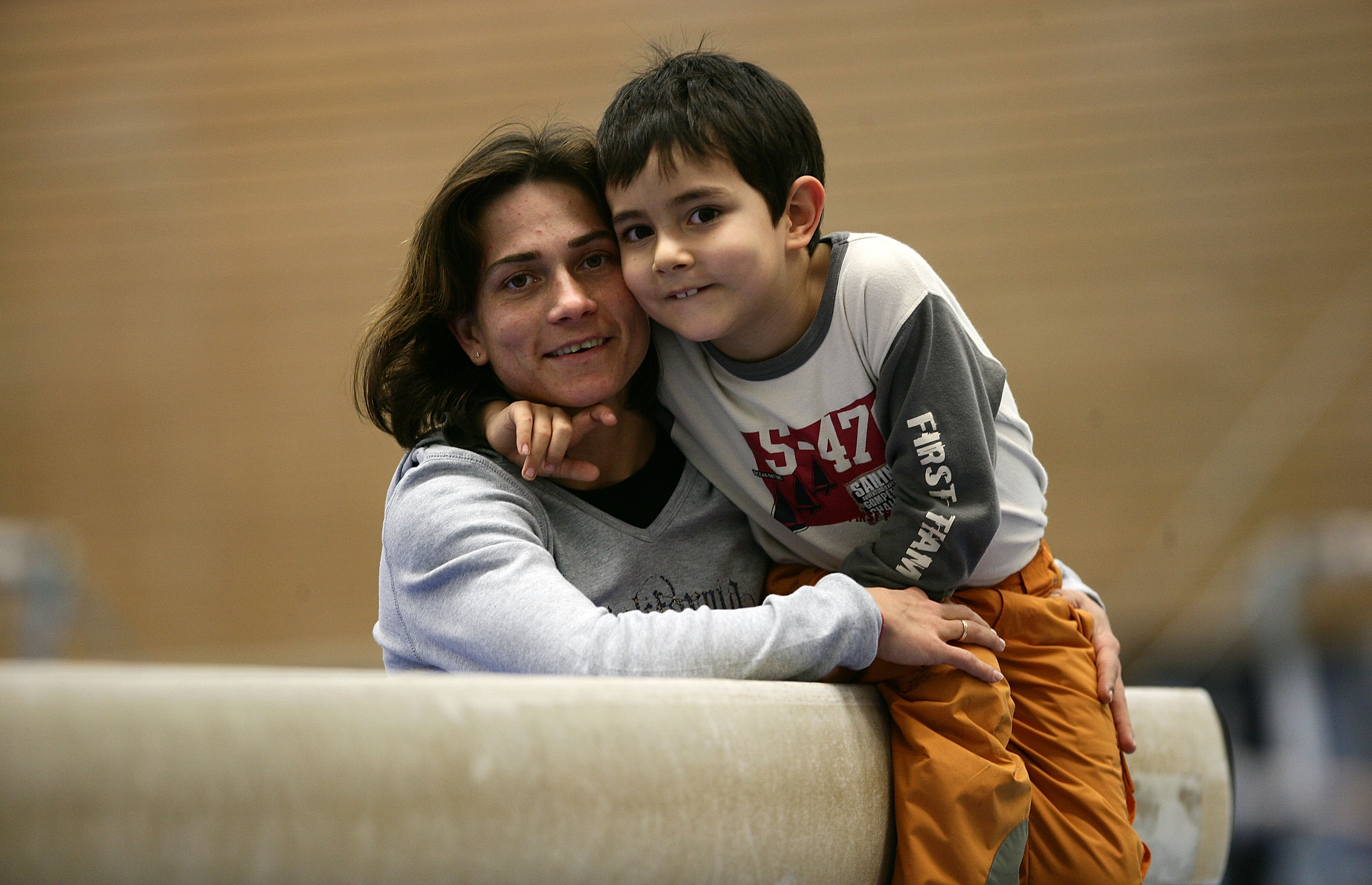 COLOGNE, GERMANY - DECEMBER 04:  German gymnast Oksana Chusovitina pose for a photo with her son Alisher prior to the training on December 04, 2006 in Cologne, Germany.  (Photo by Vladimir Rys/Bongarts/Getty Images)