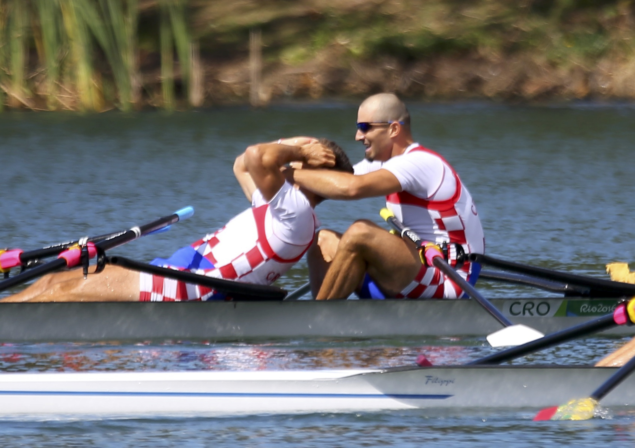 2016 Rio Olympics - Rowing - Final - Men's Double Sculls Final A - Lagoa Stadium - Rio De Janeiro, Brazil - 11/08/2016. Martin Sinkovic (CRO) of Croatia and Valent Sinkovic (CRO) of Croatia react after winning gold medals at the finish. REUTERS/Murad Sezer FOR EDITORIAL USE ONLY. NOT FOR SALE FOR MARKETING OR ADVERTISING CAMPAIGNS.   - RTSMNVB