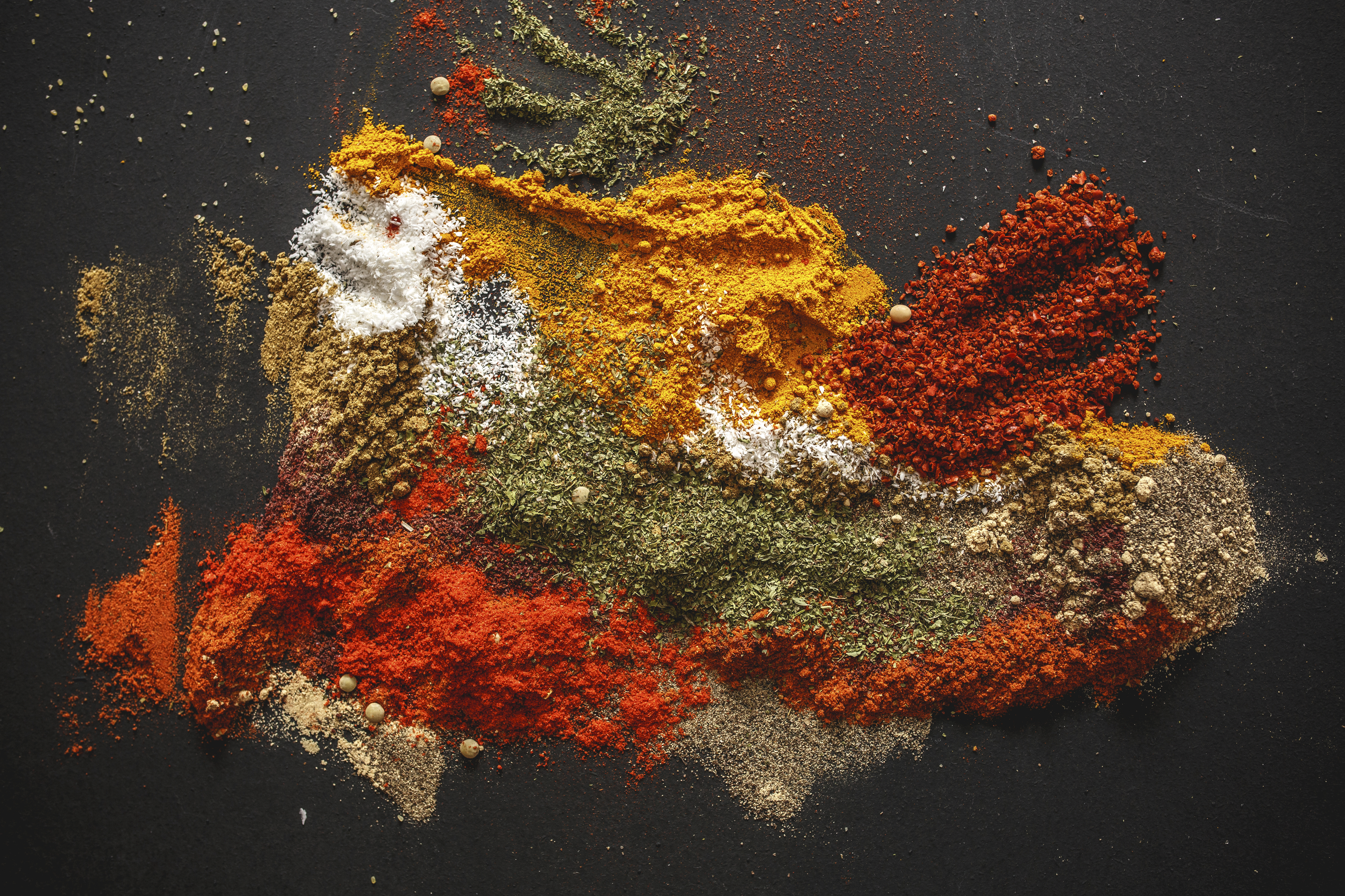 Various kinds of spices on black background.