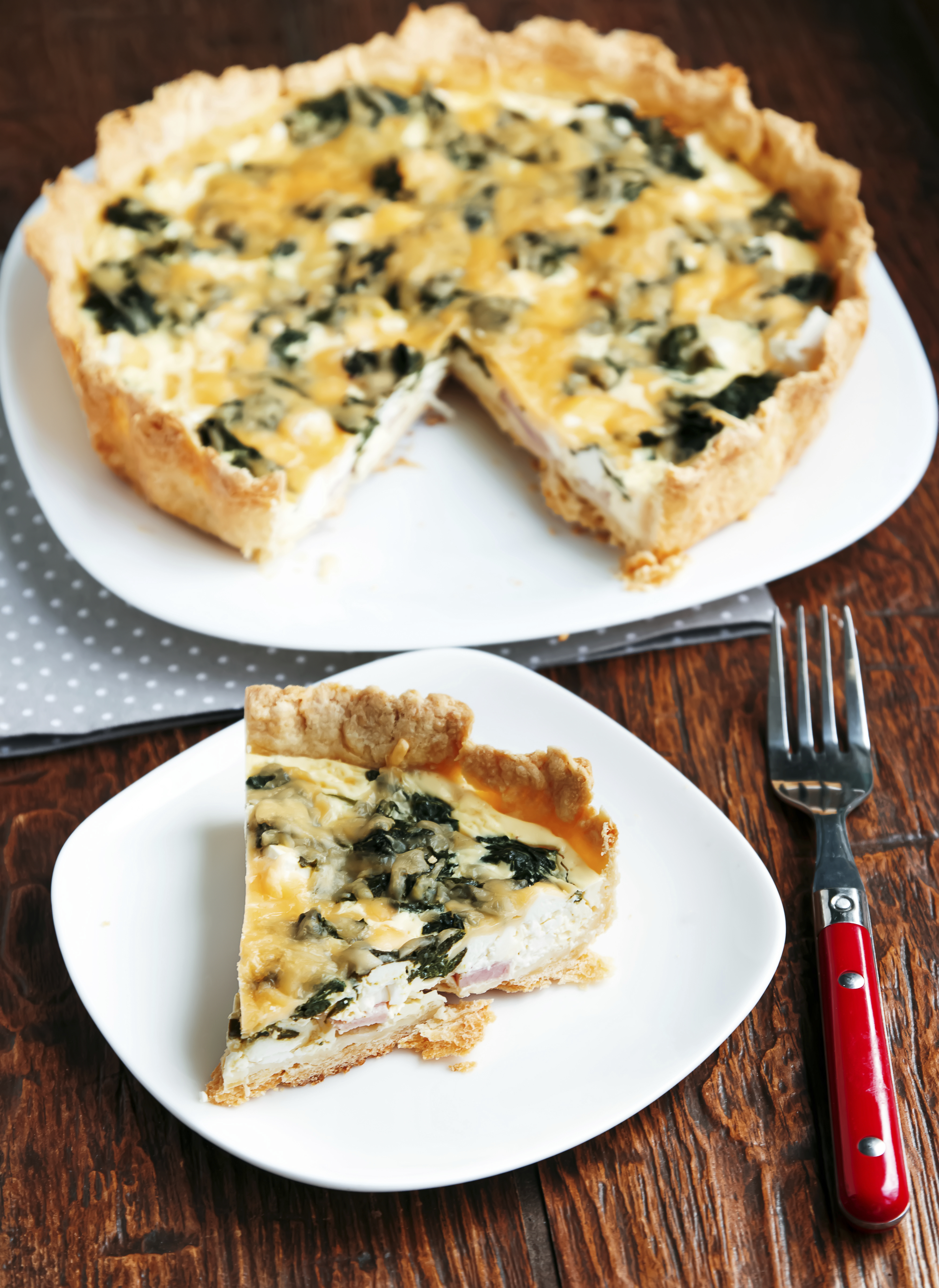 Spinach and feta quiche on the plate close-up