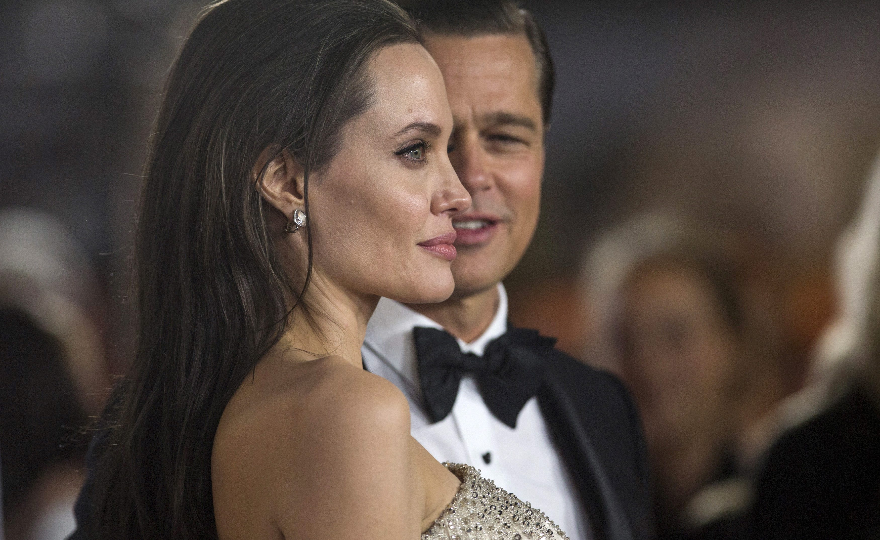 Director and cast member Angelina Jolie and her husband and co-star Brad Pitt pose at the premiere of