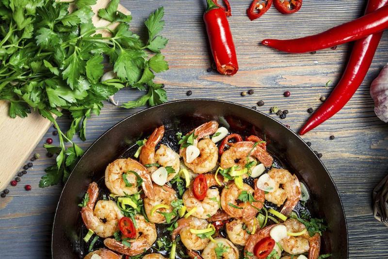 closeup-of-shrimps-fried-on-pan-and-fresh-herbs.bin