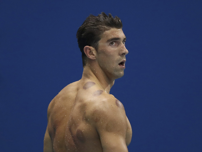 2016 Rio Olympics - Swimming - Final - Men's 200m Butterfly Semifinals - Olympic Aquatics Stadium - Rio de Janeiro, Brazil - 08/08/2016. Michael Phelps (USA) of USA reacts. REUTERS/Stefan Wermuth FOR EDITORIAL USE ONLY. NOT FOR SALE FOR MARKETING OR ADVERTISING CAMPAIGNS.
