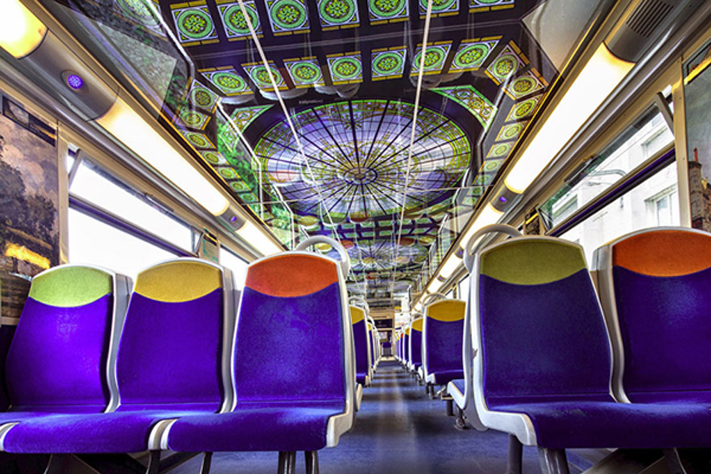 French Trains Are Being Turned Into Moving Art Museums  Instead of encouraging people to visit their world-famous landmarks, France's national state-owned rail service SNCF has come up with a fantastic idea. They've decided to bring these landmarks to you, and you can enjoy them at your leisure during your morning commute to work. Working in collaboration with American manufacturing company 3M, the SNCF has been giving trains a series of artistic makeovers. They cover the interiors with graphic film that contains various famous works of art for passengers to peruse. Designs include flowers and furnishings from the Palace of Versailles, impressionist art from the Musée d'Orsay and images from Cinéma Gaumont, the oldest film company in the world. Not only has the series, titled Art In Transit, helped to make life more interesting for passengers; it's also apparently helped to deter vandals from damaging the trains.  ©Exclusivepix Media, Image: 286494341, License: Rights-managed, Restrictions: , Model Release: no, Credit line: Profimedia, Exclusivepix