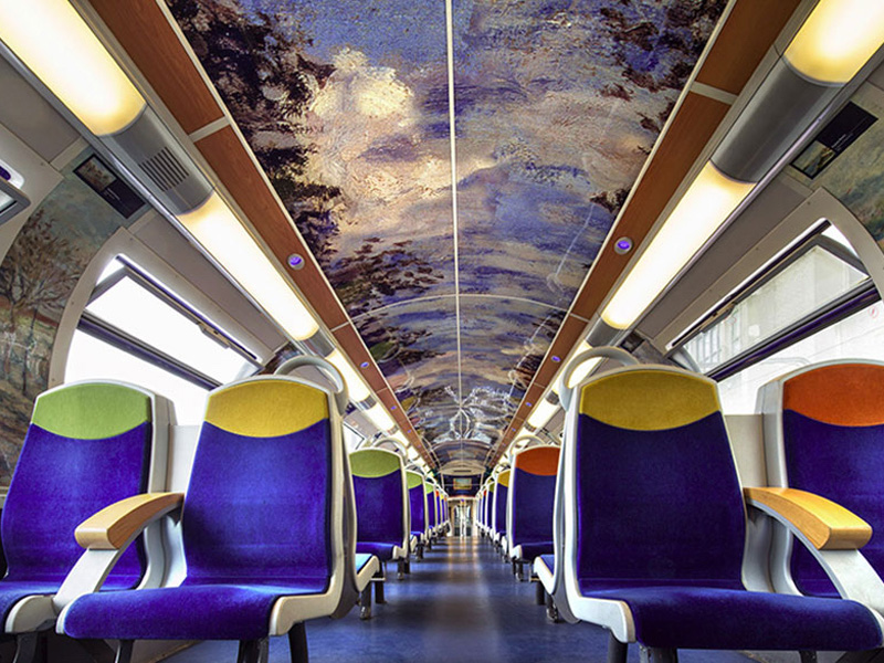 French Trains Are Being Turned Into Moving Art Museums..Instead of encouraging people to visit their world-famous landmarks, FranceÕs national state-owned rail service SNCF has come up with a fantastic idea. TheyÕve decided to bring these landmarks to you, and you can enjoy them at your leisure during your morning commute to work..Working in collaboration with American manufacturing company 3M, the SNCF has been giving trains a series of artistic makeovers. They cover the interiors with graphic film that contains various famous works of art for passengers to peruse. Designs include flowers and furnishings from the Palace of Versailles, impressionist art from the MusŽe dÕOrsay and images from CinŽma Gaumont, the oldest film company in the world..Not only has the series, titled Art In Transit, helped to make life more interesting for passengers; itÕs also apparently helped to deter vandals from damaging the trains. .©Exclusivepix Media, Image: 286495327, License: Rights-managed, Restrictions: * France, Germany, Italy and United Kingdom Rights OUT *, Model Release: no, Credit line: Profimedia, Zuma Press - News