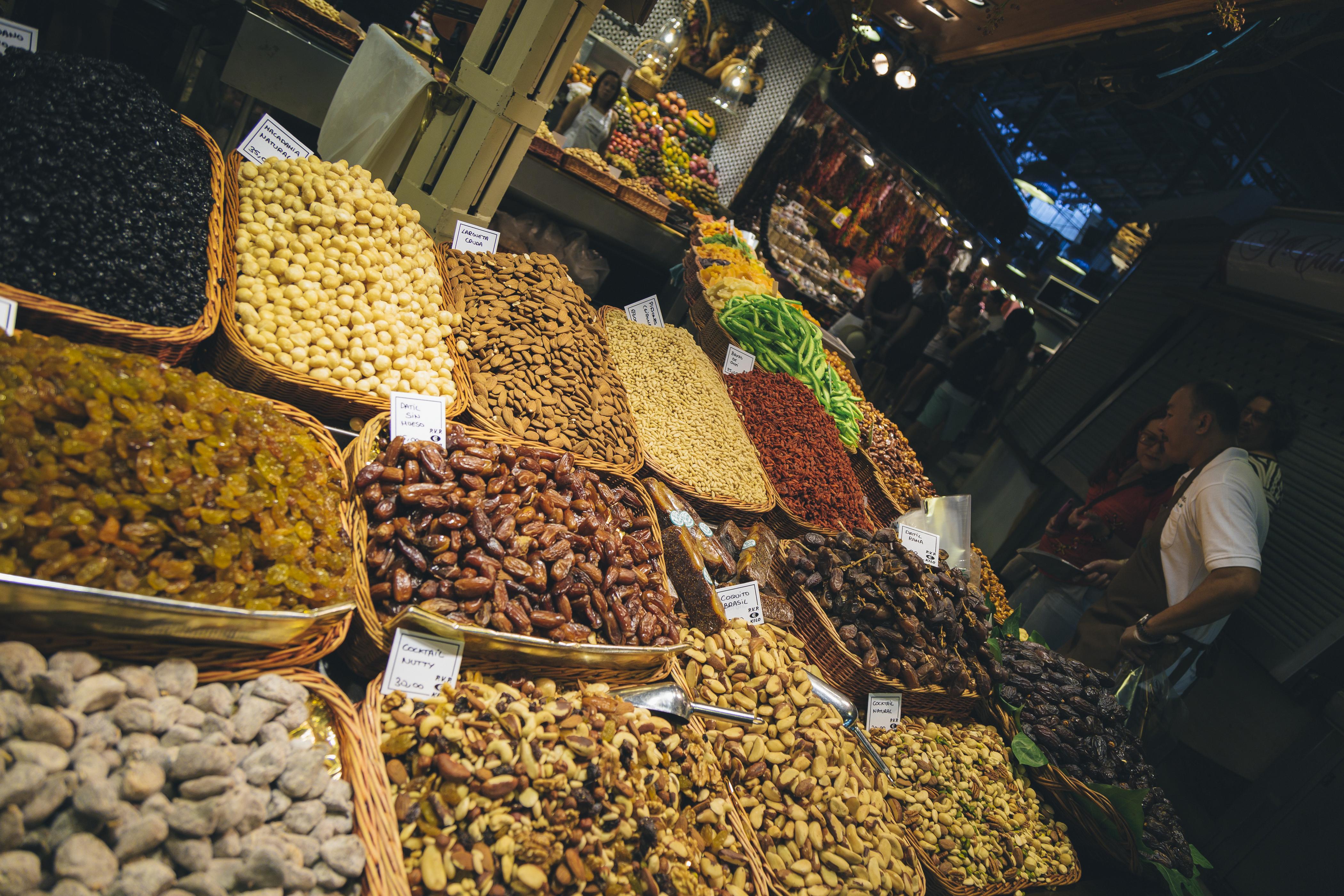 Barcelona, Spain - July 4, 2015: The historic Mercat de la Boqueria or Sant Josep Mercat (Boqueria market) in Barcelona, aside the Rambla. People and tourists walking in the building.