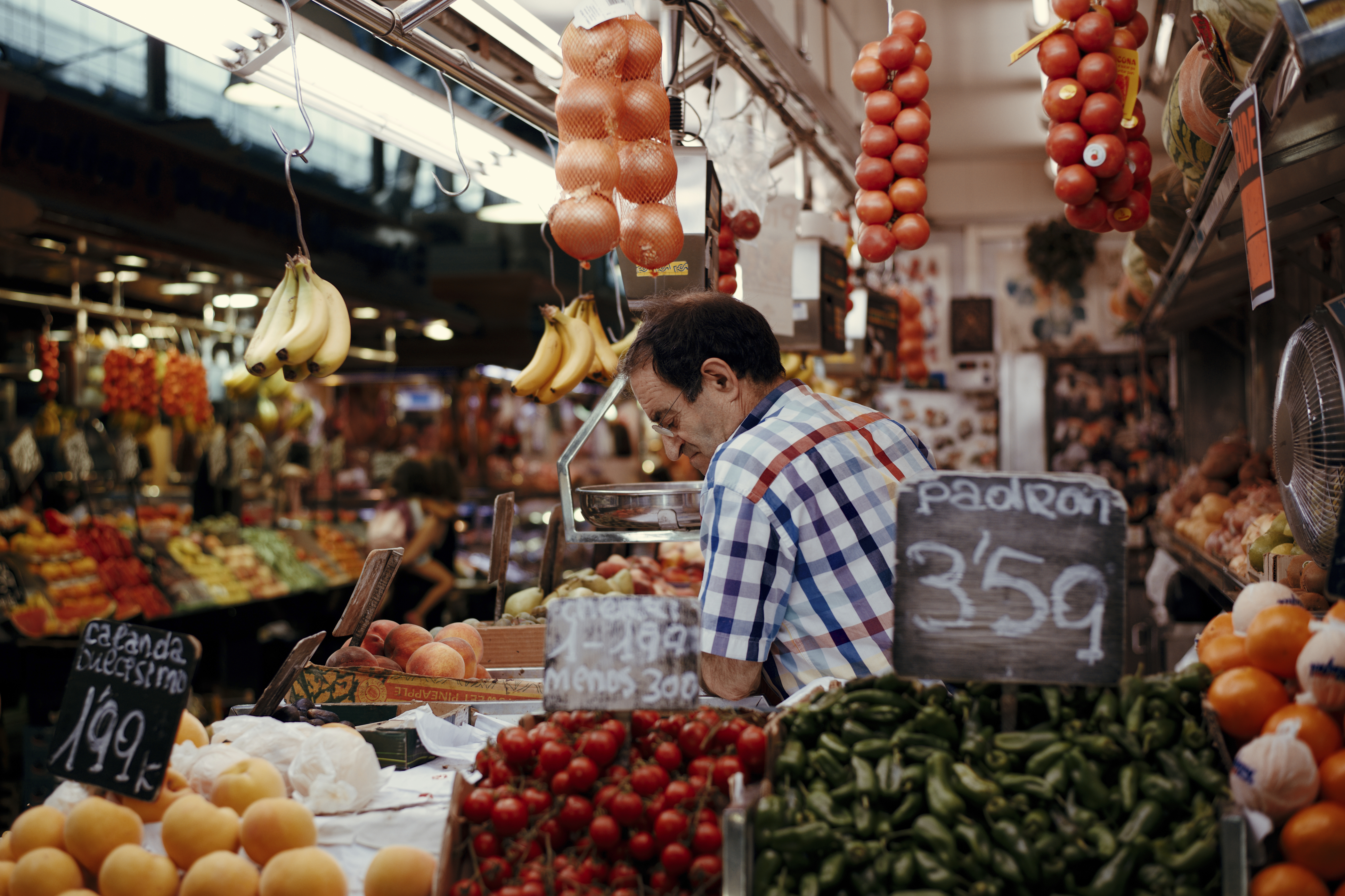 Barcelona, Spain - September 30, 2014: People visit and buy food in the most famous market in the city called La Boqueria in Barcelona