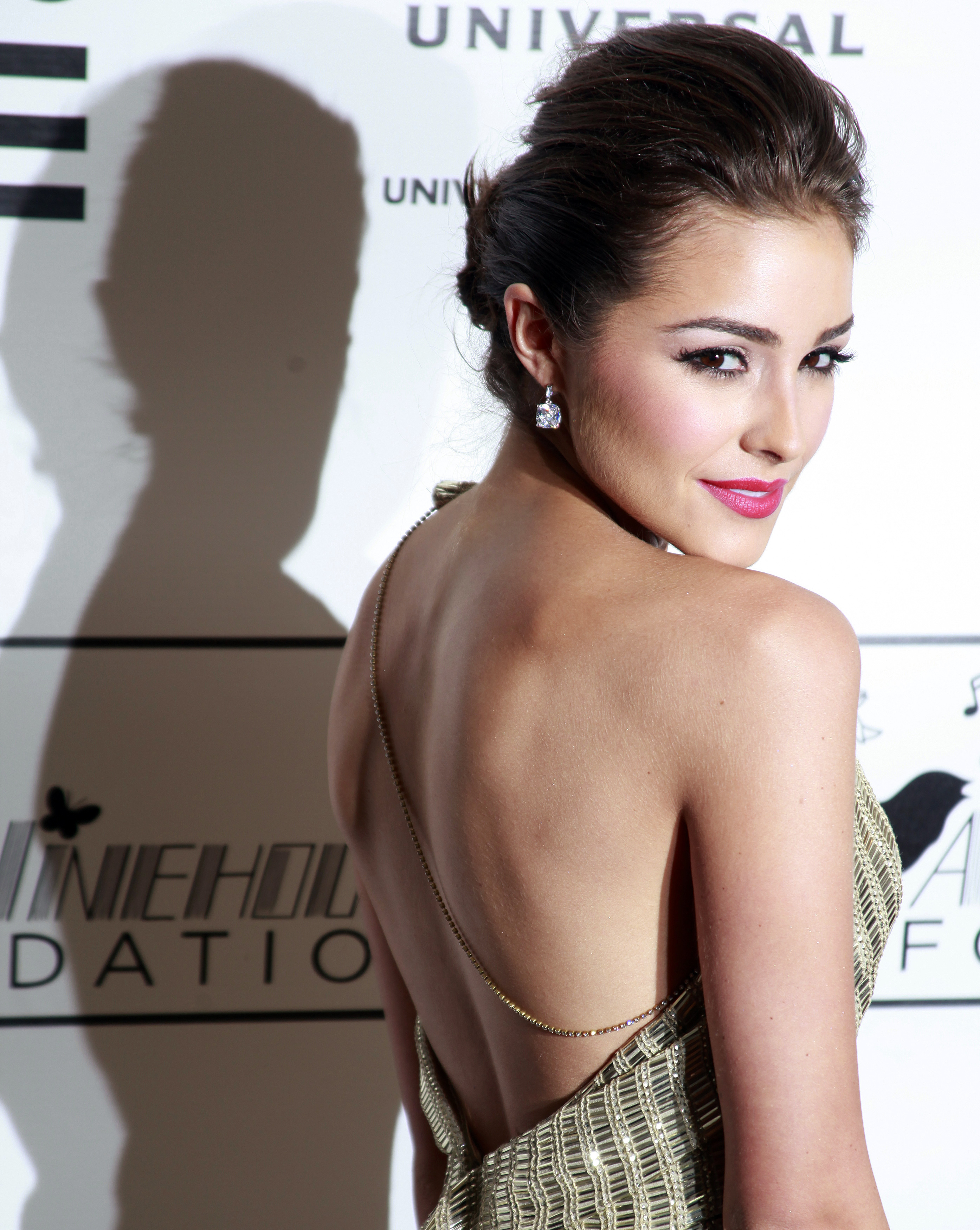 Miss Universe 2012 Olivia Culpo arrives for the Amy Winehouse Foundation Gala in New York March 21, 2013.  REUTERS/Carlo Allegri  (UNITED STATES - Tags: ENTERTAINMENT) - RTR3FAYY