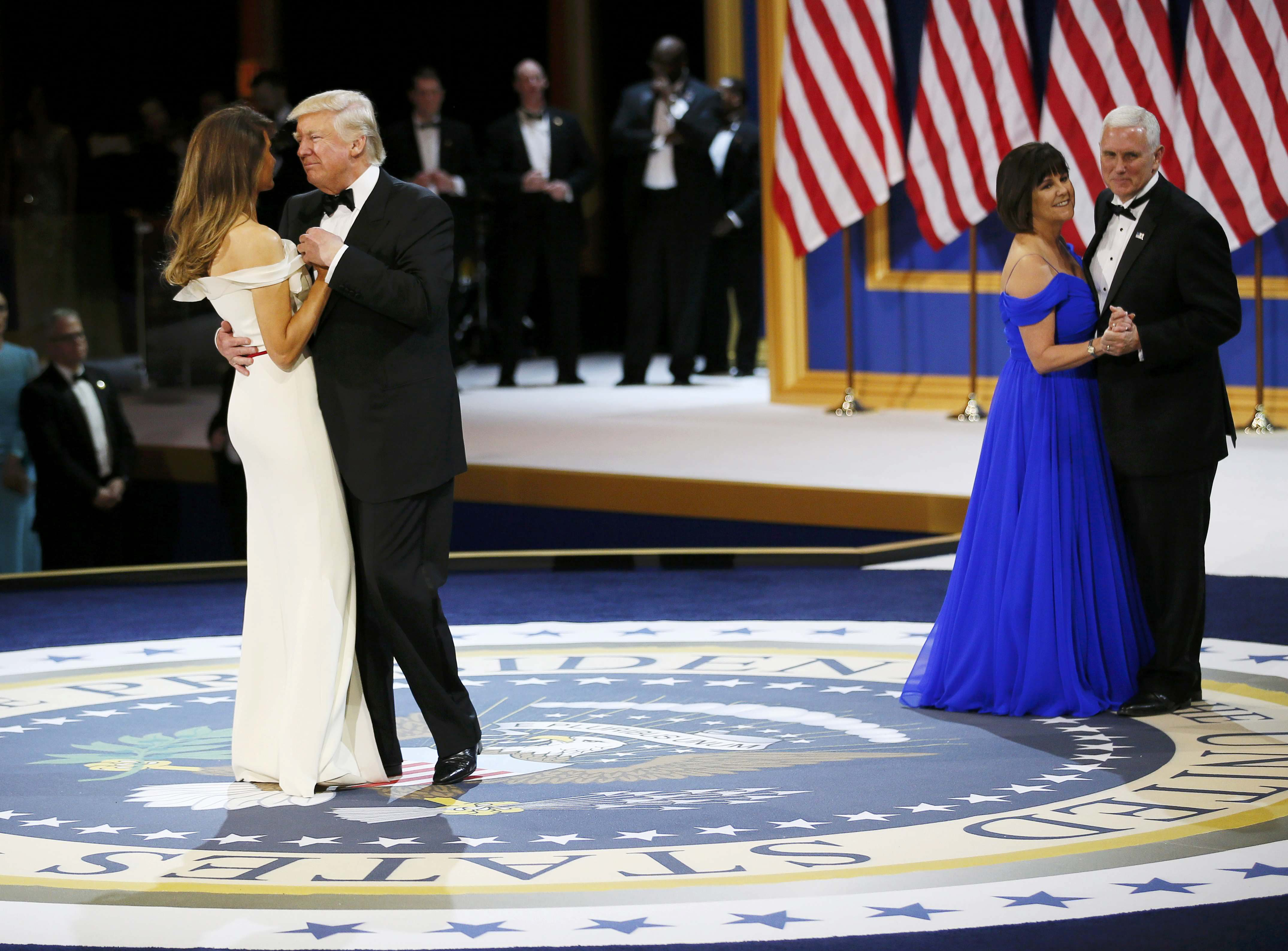 U.S. President Donald Trump and his wife first lady Melania Trump dance with Vice President Mike Pence and his wife Karen at the
