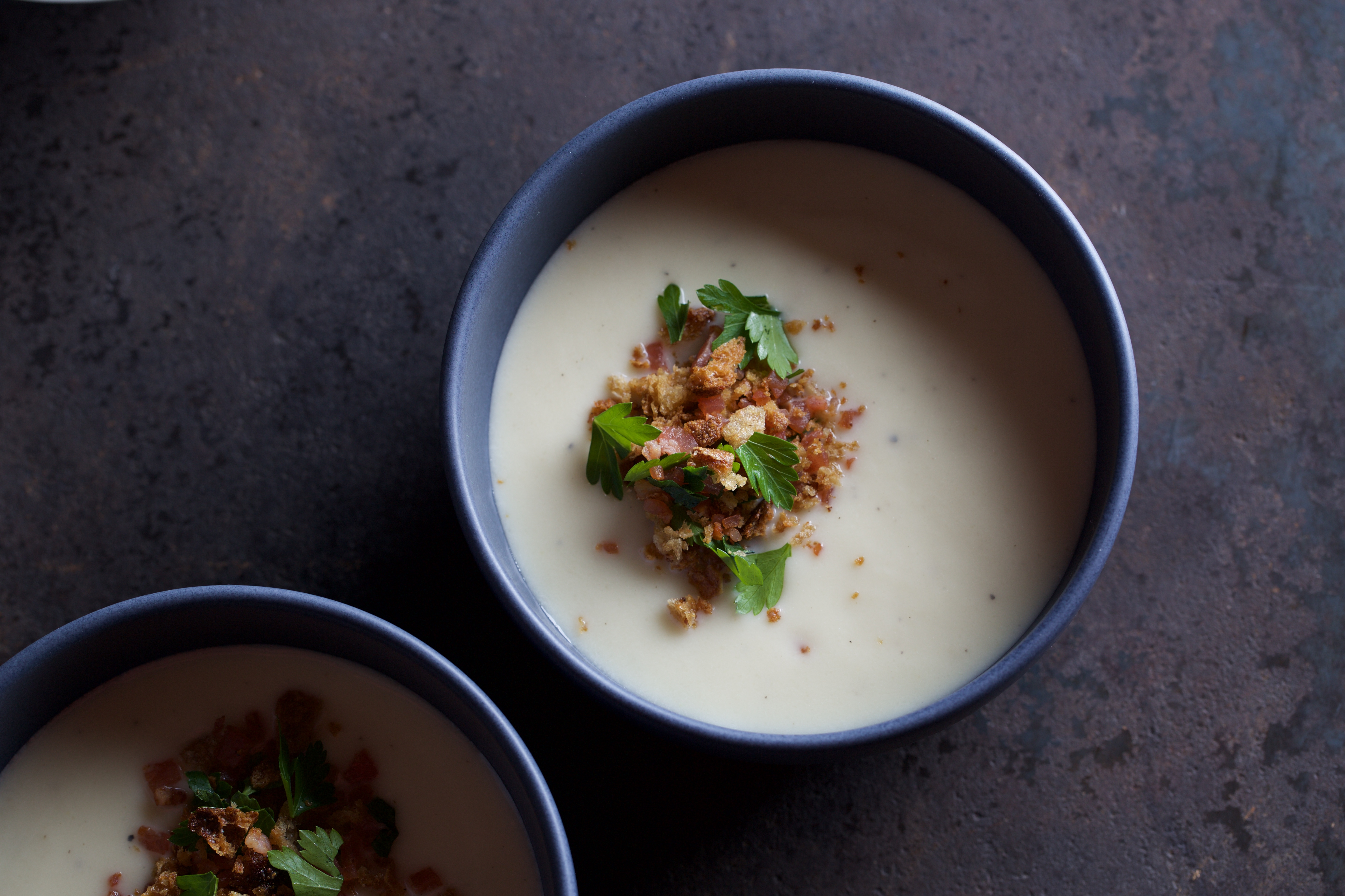 Mainly Cauliflower Soup accompnied with Sourdough Crumbs, Bacon & Parsley