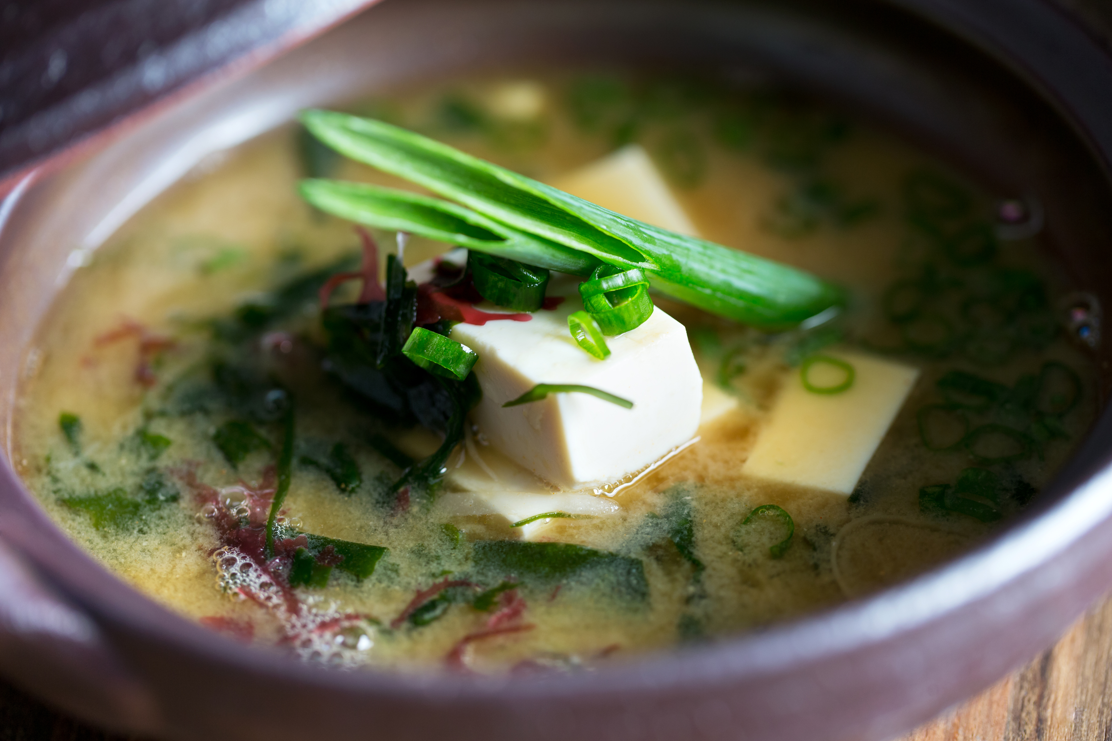 Fresh miso soup in bowl with tofu and mixed vegetables