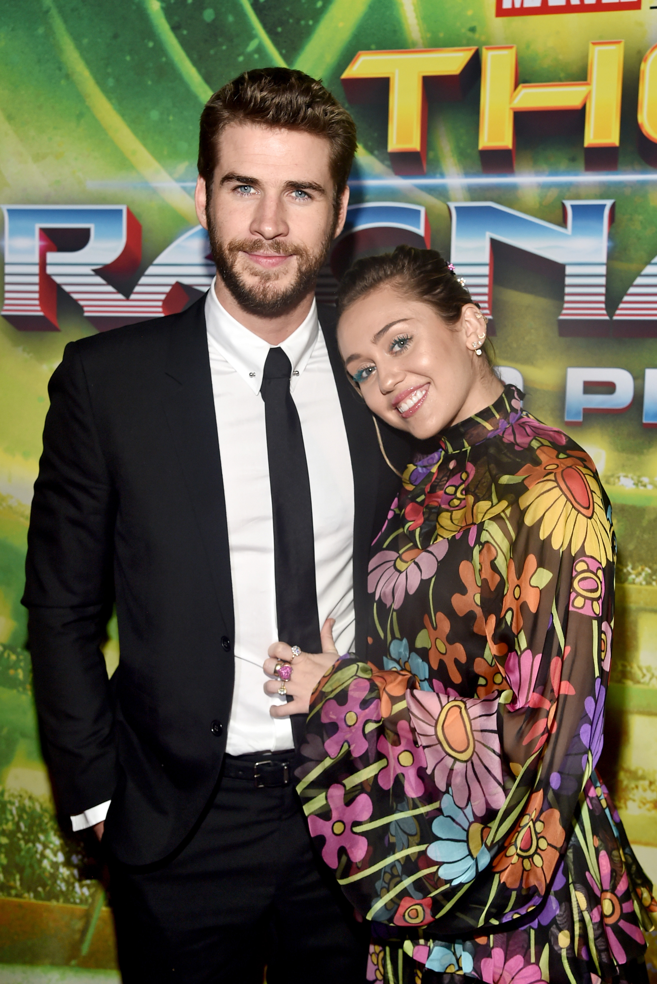 HOLLYWOOD, CA - OCTOBER 10:  Actor Liam Hemsworth (L) and Miley Cyrus at The World Premiere of Marvel Studios'