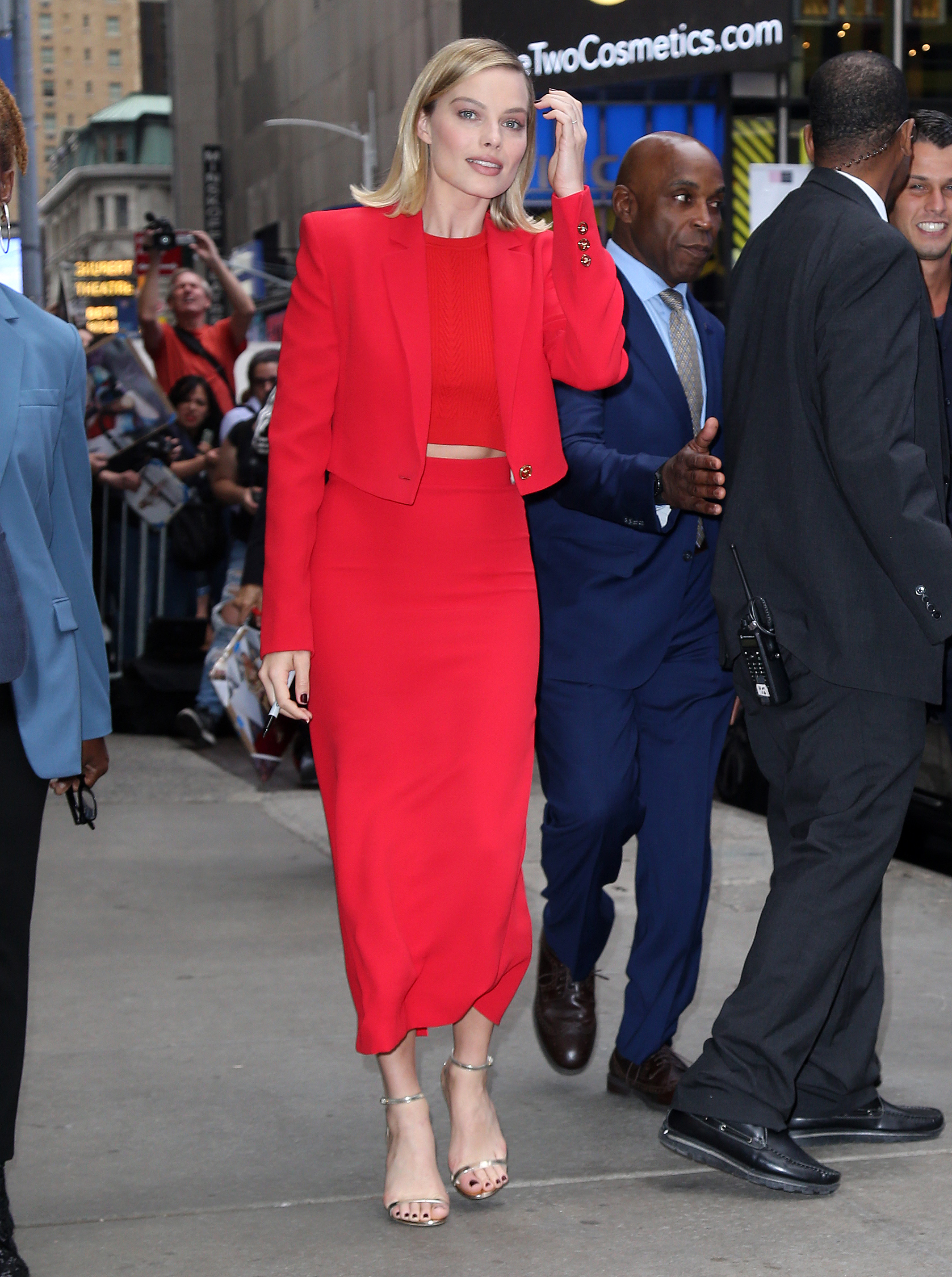 Margot Robbie leaves 'Good Morning America' wearing a red dress in New York City, New York. <P> Pictured: Margot Robbie <B>Ref: SPL1599762  111017  </B><BR/> Picture by: Splash News<BR/> </P><P> <B>Splash News and Pictures</B><BR/> Los Angeles:310-821-2666<BR/> New York:212-619-2666<BR/> London:870-934-2666<BR/> <span id=
